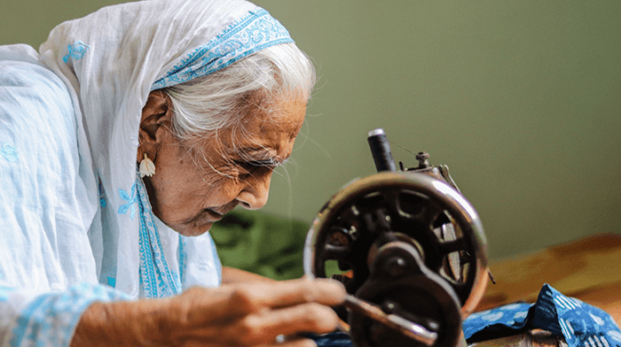Indian woman sewing - Quilt Festival in India 2023