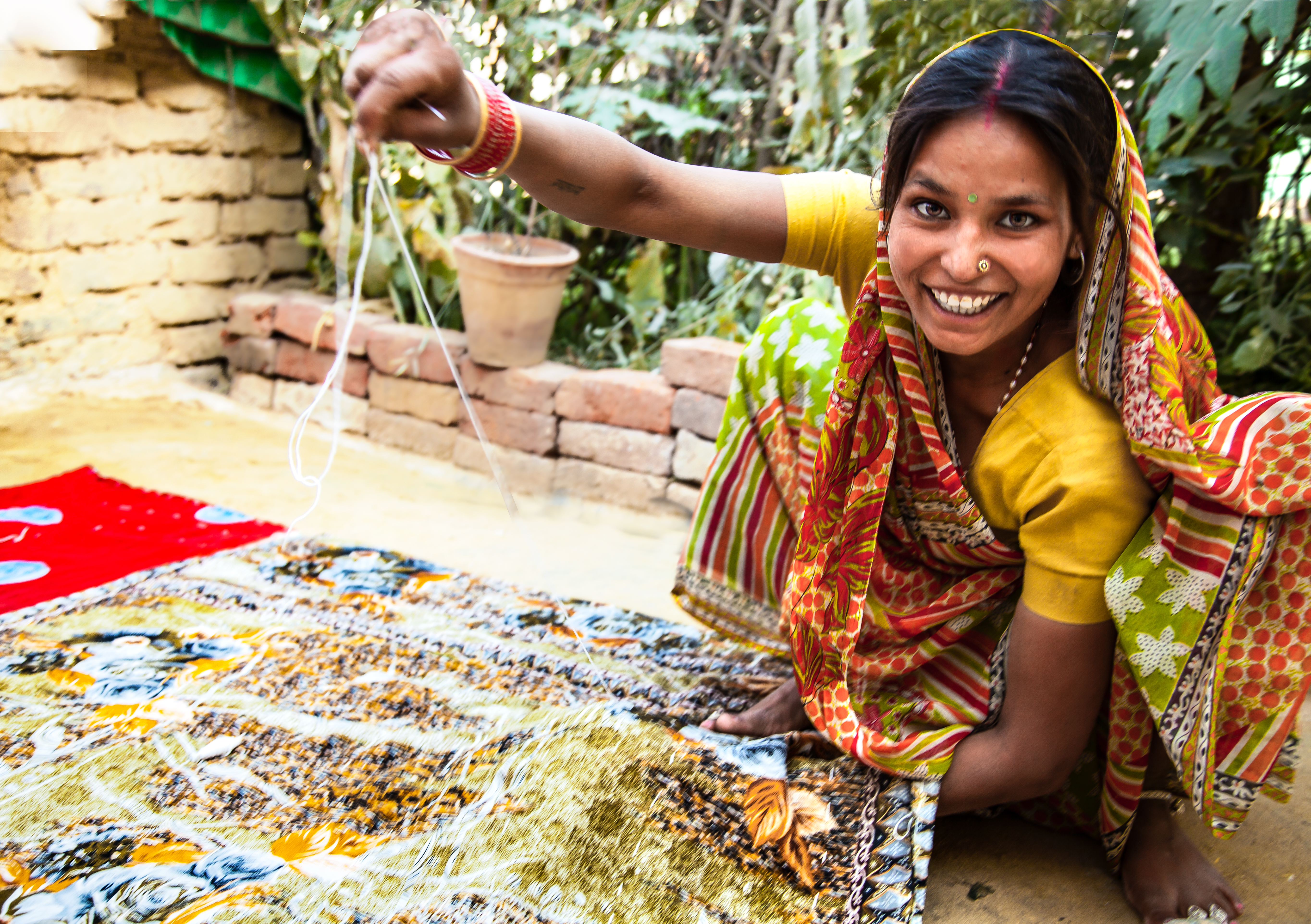Woman quilting sewing craft India